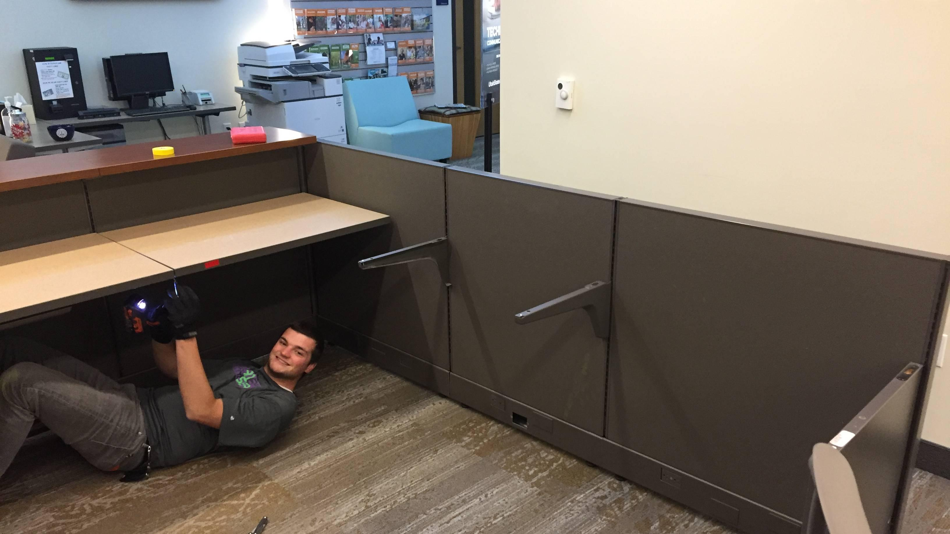 Fun on the job - smilling under the desk
